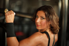 Fitness, sport, powerlifting people concept sporty woman exercising barbell. Fitness, sport, powerlifting and people concept - sporty woman exercising with Royalty Free Stock Photography