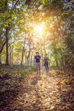 Fitness, sport, training and lifestyle concept - couple jogging stock photography