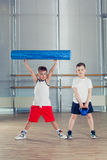 Fitness, sport, training lifestyle concept - children in the gym weights and with foam roller. Fitness, sport, training and lifestyle concept - children in the stock photos