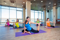 Fitness, sport, training and lifestyle concept -. Group of smiling women stretching in gym Royalty Free Stock Images