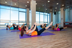 Fitness, sport, training and lifestyle concept -. Group of smiling women stretching in gym Stock Image