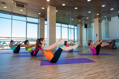 Fitness, sport, training and lifestyle concept -. Group of smiling women stretching in gym Stock Photos