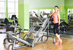 Fitness, sport, training and lifestyle concept - happy woman in gym Royalty Free Stock Images