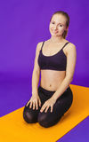 Fitness, sport, training and lifestyle concept - smiling woman doing exercises on mat in gym Royalty Free Stock Photography