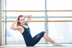 Fitness, sport, training and lifestyle concept -. Fitness. sport, training and lifestyle concept - woman doing exercises on mat in gym royalty free stock images