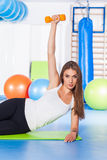 Fitness, sport, training and lifestyle concept - woman doing phy Stock Images