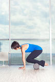 Fitness, sport, training and lifestyle concept - woman doing pilates on the floor with foam roller Royalty Free Stock Images
