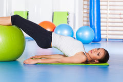 Fitness, sport, training and lifestyle concept - woman stretchin Stock Photos