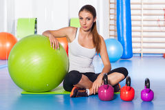 Fitness, sport, training and lifestyle concept - woman stretchin Stock Photo