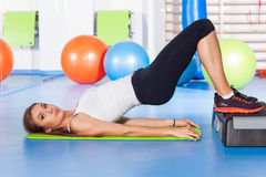 Fitness, sport, training and lifestyle concept - woman stretchin Stock Images