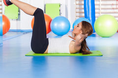 Fitness, sport, training and lifestyle concept - woman stretchin Royalty Free Stock Images