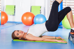 Fitness, sport, training and lifestyle concept - woman stretchin Stock Image