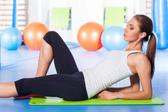 Fitness, sport, training and lifestyle concept - woman stretching Stock Photos