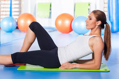 Fitness, sport, training and lifestyle concept - woman stretching Royalty Free Stock Image
