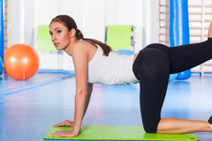Fitness, sport, training and lifestyle concept - woman stretching Stock Images