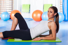 Fitness, sport, training and lifestyle concept - woman stretching Royalty Free Stock Images