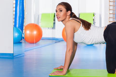 Fitness, sport, training and lifestyle concept - woman stretching Royalty Free Stock Photography