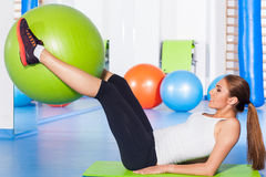 Fitness, sport, training and lifestyle concept - woman stretching Stock Image