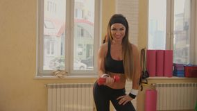 Fitness, sport, training and people concept - happy woman exercising with dumbbells. 4k stock footage