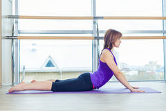 Fitness, sport, training and people concept - smiling woman doing abdominal exercises on mat in gym Royalty Free Stock Photo
