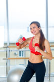 Fitness, sport, training and people concept -  Woman exercising with dumbbells Stock Image