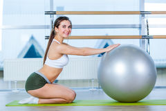 Fitness, sport, training and people concept - woman with fitness ball Royalty Free Stock Image