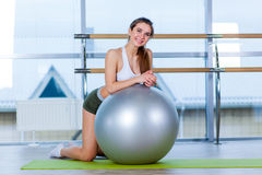Fitness, sport, training and people concept - woman with fitness ball Stock Photo