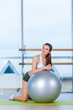 Fitness, sport, training and people concept - woman with fitness ball Stock Photos