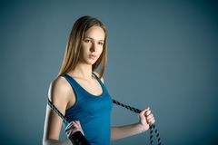 Fitness, sport, training, people and lifestyle concept - young woman or teen doing exercises with expander or resistance band. Fitness, sport, training, people Stock Image