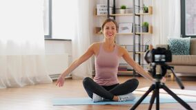 Woman or sports blogger streaming online yoga