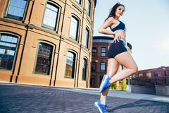 Fitness sport woman in sportswear doing fitness exercise in the city street. royalty free stock photography