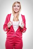 Fitness sport woman white towel on shoulders, studio shot. Fitness sport woman portrait studio shot. Smiling happy female sporty girl with white towel on Stock Photo