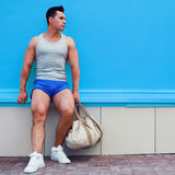 Fitness, sport and workout concept - handsome sportsman with bag Stock Image