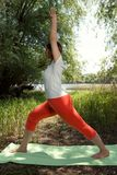 Fitness, sport, yoga and healthy lifestyle- young woman meditati Stock Photos