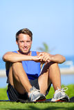 Fitness sports athlete man relaxing after training Stock Photos