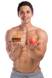 Fitness sports fit diet apple fruit hamburger healthy eating bod. Ybuilder bodybuilding young man isolated on a white background Stock Photo