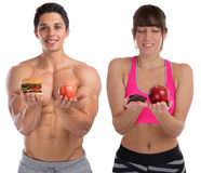 Fitness sports fit diet apple fruit hamburger healthy eating you. Ng men women isolated on a white background Royalty Free Stock Photography