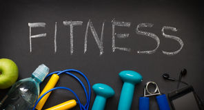 Fitness and sports gear on blackboard Stock Photography