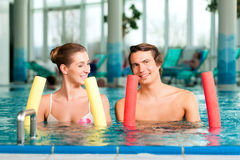 Fitness - sports and gymnastics in swimming pool Stock Photo
