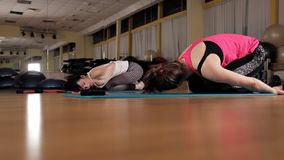 Fitness, sports, training, gym and lifestyle concept - women exercising on gym mats.  stock video footage