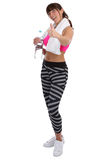 Fitness sports woman drinking water showing thumbs up full body Royalty Free Stock Images