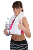 Fitness sports woman drinking water showing thumbs up isolated Royalty Free Stock Photography