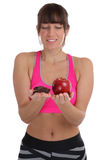Fitness sports young fit slim woman diet losing weight apple fru Royalty Free Stock Images