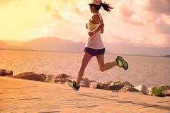sportswoman running on sunny coast stock photos