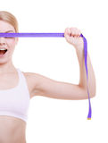 Fitness sporty girl covering her eyes with measuring tape isolated Royalty Free Stock Photography