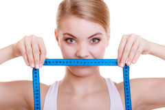 Fitness sporty girl covering her mouth with measuring tape isolated Royalty Free Stock Image
