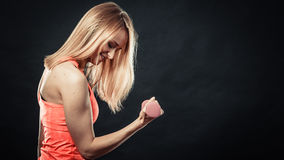 Fitness sporty girl lifting weights Stock Image