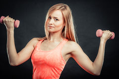 Fitness sporty girl lifting weights Royalty Free Stock Image