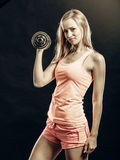 Fitness sporty girl lifting weights Stock Images