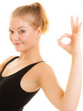 Fitness sporty girl showing ok okay hand sign gesture Royalty Free Stock Image